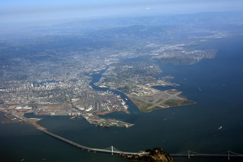 Bay Bridge and Oakland, 11 May 2019 - 1647.  Looking south east across the San Francisco Bay Bridge towards the former Alameda Naval Air Station.