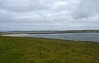 Churchill barrier No 1, Orkney, 26 May 2015.  Looking north west from near the Italian chapel on the island of Lamb Holm (foreground) towards the Orkney mainland.  The Scapa Flow anchorage is just visible in the distance at far left, beyond Howequay Head.  The stretch of water between Lamb Holm and the mainland is Kirk Sound.  Early on 14 October 1939 U-47, commanded by Kapitanleutnant Gunther Prien, evaded blockships that had been sunk in the sound and entered Scapa Flow while surfaced.  He torpedoed and sank the battleship HMS Royal Oak with the loss of 833 men before making his way back past the blockships into the North Sea.  His was not the first U-boat to attempt to enter Scapa flow.  There had been two attempts during the First World War; both U-boats were detected and destroyed.  The loss of Royal Oak in a supposedly secure anchorage was a tremendous shock, and Churchill ordered the construction of four barriers between islands on the eastern side of Scapa Flow to prevent a repetition.