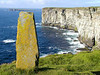 Standing stone near Marwick Head with Brough of Birsay in the background