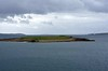 Looking south east from Stromness into Clestrain Sound, 27 May 2015.  Hoy Sound Low lighthouse at right is on the eastern end of Graemsay.