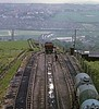 Corkickle Brake incline, Whitehaven, 9 June 1973.   Looking east towards Corkickle and the main line from Whitehaven to Barrow.  The rope-worked incline lifted wagons 250 feet from this line.  Wagons can be seen at the foot of the Brake in the distance. Corkickle Brake closed in 1986.  Photo by Les Tindall.