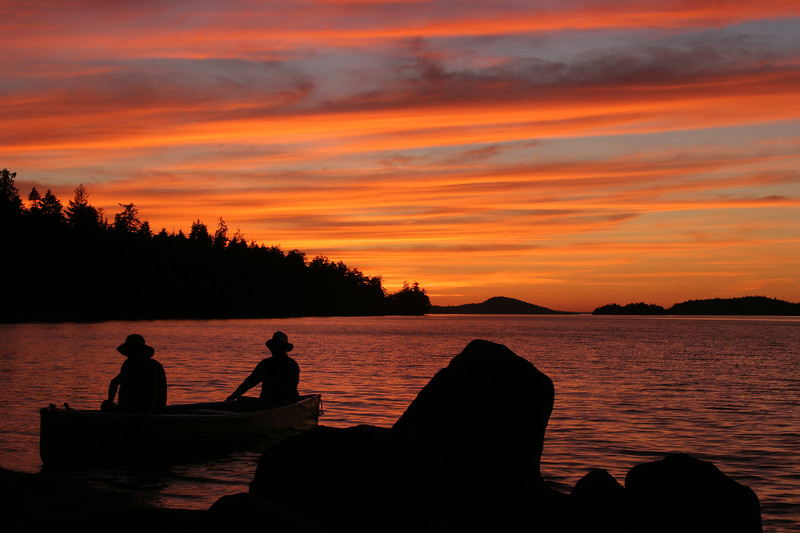 Salt Spring Island BC Canada-- Canoers return after a fine day on the water.