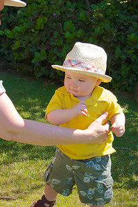 Grandma trying to get a picture of Edmund with his hat