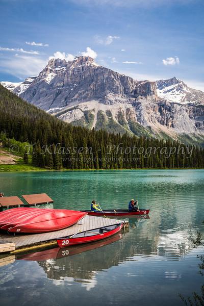 A canoe with mountain reflections on Emerald Lake, Yoho National Park, British Columbia, Canada.