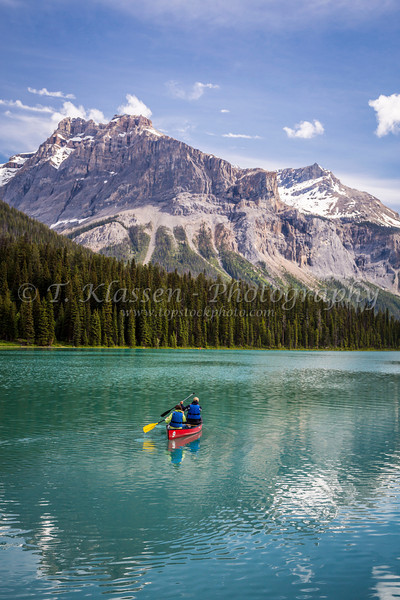 A canoe with mountain reflections on Emerald Lake, Yoho National Park, British Columbia, Canada.