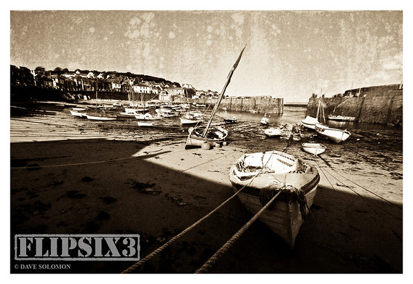Sepia toned attempt at a 'vintage postcard' look for Mousehole Harbour, Cornwall