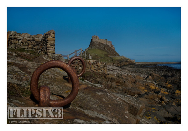 Holy Island Castle and rusted mooring rings
