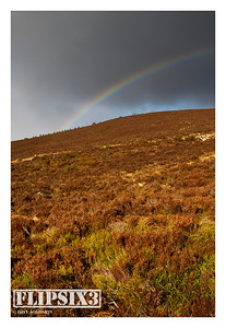 Views of/from Meall a'Bhuachaille: On the way up, with a rainbow emerging over the neighbouring summit