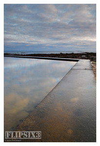As the tide goes out, this man-made wall is revealed which forms a large tidal-pool at low water