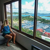The east end of Tortola stretches out below the house with a yacht harbor and the airport...