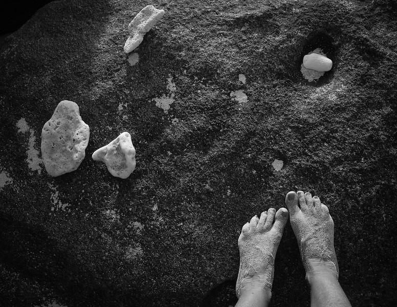 Gorda2012-126 -- Personal Composition -- here I am warming myself and drying off after a swim -- perched on a boulder in the late afternoon sun. I happened to look down and snap this shot with bits of coral and my sandy feet.