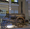 Rocket, Science Museum, London, 28 January 2005 1.  The original 1829 Stephenson loco and Rainhill winner.  Rocket worked on the Liverpool & Manchester Rly until 1836.  It was then sold to the Earl of Carlisle's Rly at Brampton in what is now Cumbria, where it worked until 1862.  It is preserved with extensive modifications made after the trials, in particular its cylinders were lowered for steadier running.