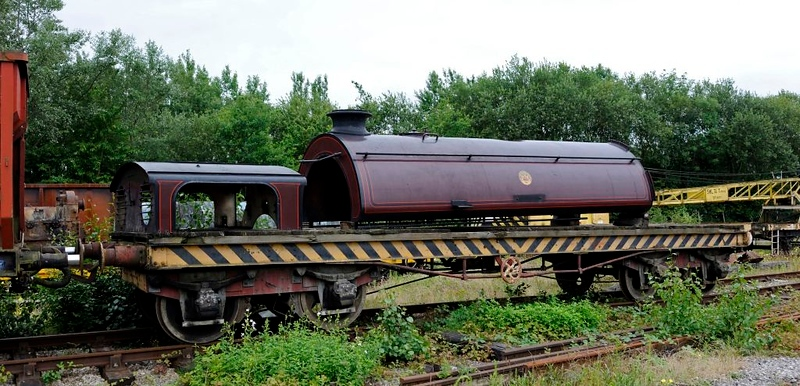 Furness Rly 25 ton bogie bolster 5999, Preston Riversway, 20 July 2011 1.  No Furness Rly coaches survive, and this is the only wagon.  Built in 1918, it was acquired by the Furness Rly Trust in 2011 and moved from the Midland Rly Centre to the Ribble Steam Rly.  The saddletank and cab roof from the Trust's Austerity 0-6-0ST Cumbria are sitting on it.  Here are seven photos.