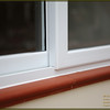 Sliding uPVC window frames with silicon sealing above clay bullnose window cill.