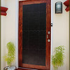 Nara and ceramic front door with stainless steel door furniture, aluminium weather bar and mahogany door cill.