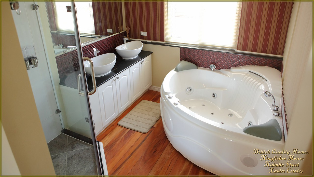 Ensuite Jacuzzi Bathroom with His & Hers Wash Basins and Frameless Shower Enclosure