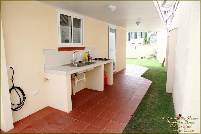 External Kitchen, Gas Storage, Generator Hook-Up and Washing Machine Point