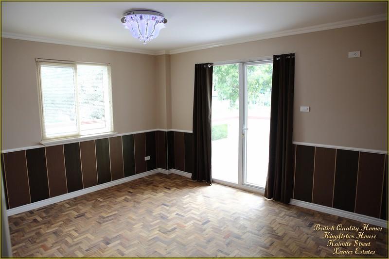 Guest Bedroom with Glazed Door to Balcony