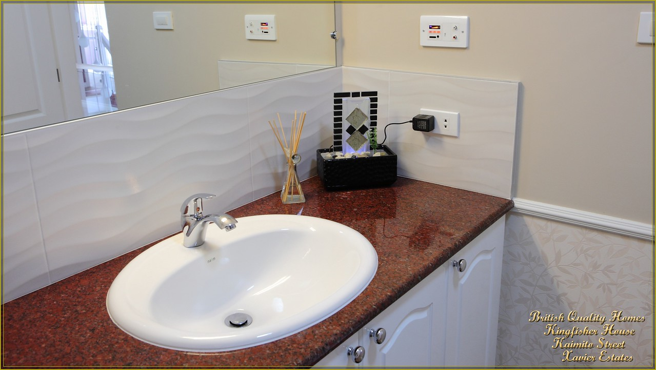 Imported UK Blutooth Wall Amplifier, Granite Vanity Unit & Inset Wash basin with Aluminium Edged Spanish Wall Tiles
