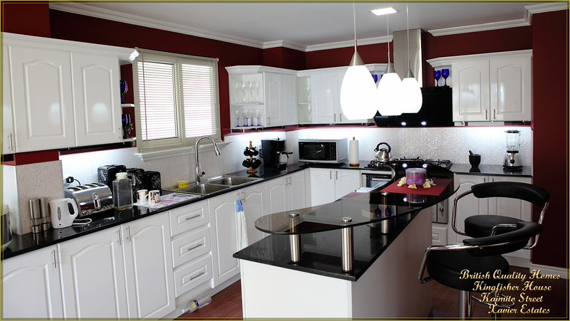 Fully Fitted Kitchen with Glazed Breakfast Bar on Central Island