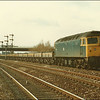 Class 47/0, 47063, heads past the down approach semaphore signals at Taunton with an engineers spoilt ballast train - 24 March 1986.