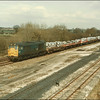 Class 31, 31327, passes through Stenson Junction with a train of steel coils - 4 April 1986.