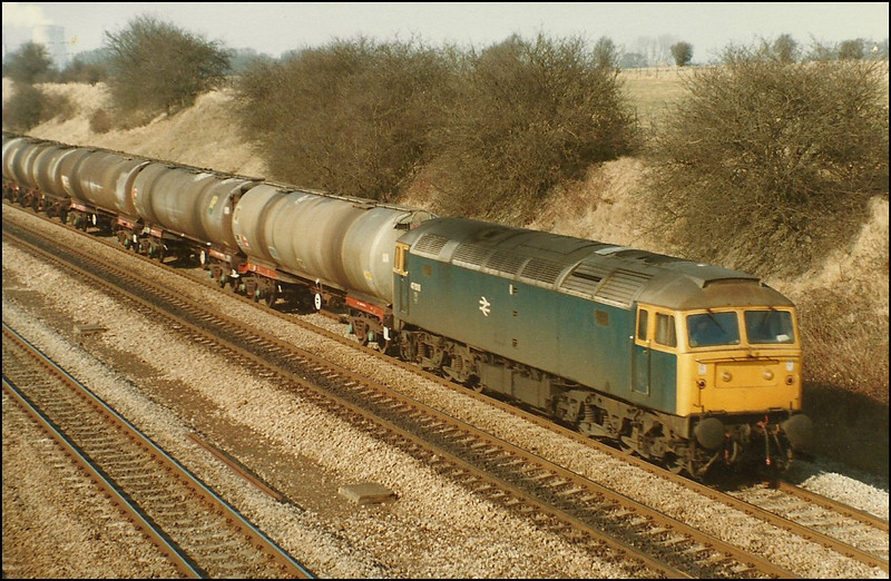 BR Blue Class 47/0 (47008) passes through South Moreton with a train of TEA oil tankers - 26 February 1986.
