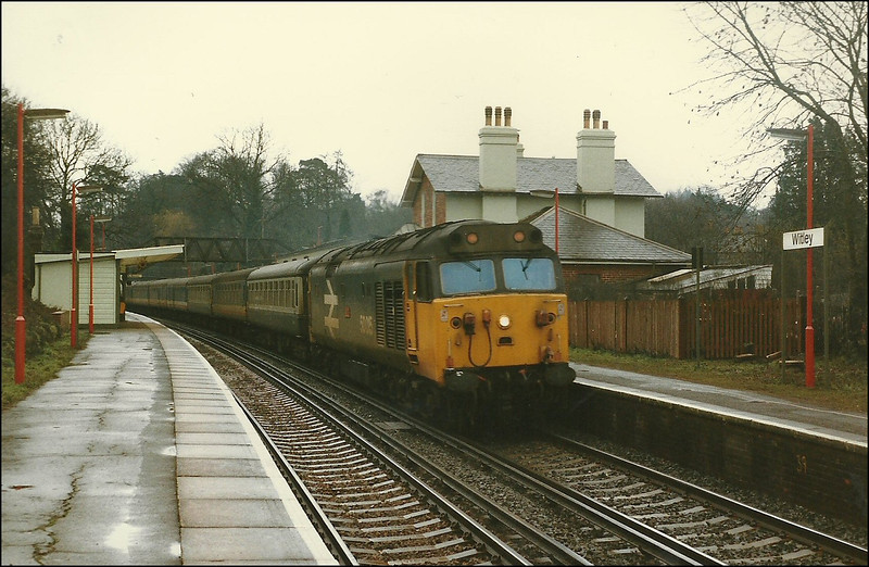 Large logo livery Class 50 (50015 'Valiant') rushes through Witley with IV11 (1110 London (Waterloo)-Exeter St. David's), again diverted due to engineering works – 1 March 1987.