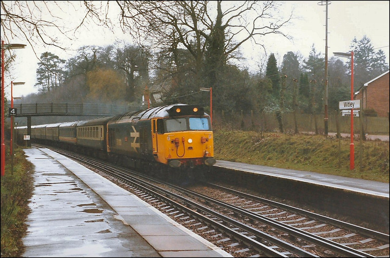 Large logo livery Class 50 (50003 'Temeraire') rushes through Witley with 0910 London (Waterloo)-Exeter St. David's, diverted via Portsmouth direct line and Southampton to Salisbury due to engineering works – 1 March 1987.