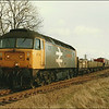 Railfreight grey-liveried Class 47 (47366) hauls 6H90, Norwich-Whitmoor Yard, through Chettisham (Nr. Ely) – 18 March 1987.