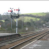 A general view in the down (Penzance) direction, showing the junction semaphore signal for the Fowey branch, from the up platform at Lostwithiel - 28 March 2006.