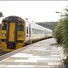 Wessex Trains Class 158 (158870) heads the 1453 Penzance-Plymouth service into Lostwithiel - 28 March 2006.