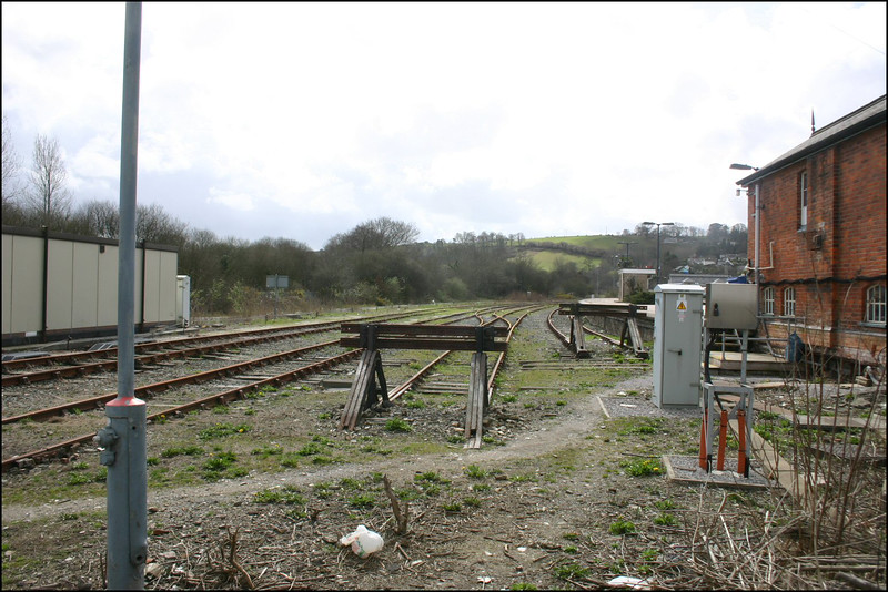 General view of the sidings on the down side of Lostwithiel Station, the back of the signal box is to the right - 28 March 2006.