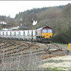 EWS liveried Class 66/0 (66002) stands in the down loop at Lostwithiel having run round its train, awaiting 'the road' to depart for Par - 28 March 2006.
