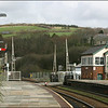 A general view in the up (Exeter/London) direction, from the up platform at Lostwithiel showing the level crossing and signal box - 28 March 2006.