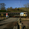 Wessex Trains Class 153 (153308) crosses the level crossing at Trenant Park to the north of East Looe with the 1444 Looe-Liskeard service - 26 January 2006.