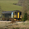 Wessex Trains Class 153 (153308) slows down to crawling pace as it approaches the level crossing near Trenant Park, north of East Looe, with the 1315 Liskeard- Looe service - 26 January 2006.