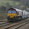 EWS liveried Class 66 (66002) slowly enters Lostwithiel Station with its train of empty china clay wagons from Fowey in order for the driver to surrender the token to the Lostwithiel signalman - 28 March 2006.