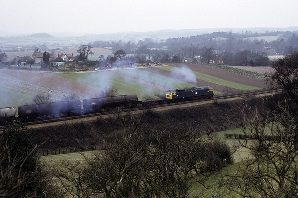 47xxx, Lickey Bank, 17 March 1973.  An unidentified Brush Type 4 struggles up the bank with a block oil train.  It was being banked by two English Electric Type 3s.  They had replaced Hymeks on Lickey banking duties the previous November.  Photo by Les Tindall.