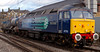 47712 Pride of Carlisle, 6Z47, Carnforth, 4 December 2008 - 1419.  47712 takes a railhead treatment wagon from Kingmoor to Crewe.  Since February it has lost its RCH cables.  It is also running without OHLE warning flashes by the handrails (at both ends).