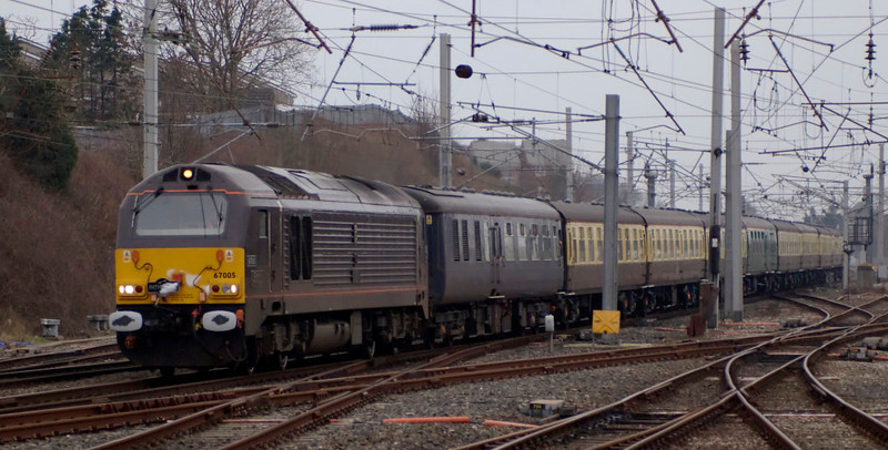 Four days after working the Royal Train, 67005 Queen's Messenger returns to the northern WCML with Pathfinder's Sawnsea - Wester Hailes (Edinburgh).  1Z55 was a ruggex for the Wales v Scotland Six Nations game on 10 February, when the ECS was to be used for Pathfinder's McBuffer Puffer tour.  NB the snow on the Pathfinder headboard on 67005.