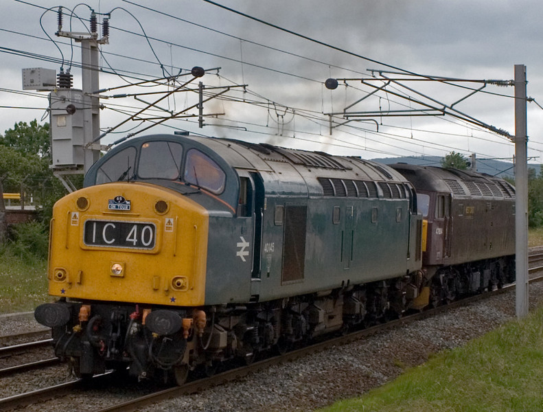 40145 & 47854, Carnforth, 25 June 2007 - 1534.   40145 runs into Carnforth loop en route from railtour duty in Scotland to the East Lancs Rly.  It dragged 47854 as far as Carnforth; the 47 had seen intensive use on the Royal Scotsman and needed to return to Steamtown for maintenance.