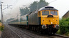 47805 Talisman & 47843 Vulcan, 1Z42, Carnforth, 21 July 2007 - 0720 1.   47805 races through the rain with Conmpass's Highland Merseyman tour from Liverpool to Dalwhinnie.