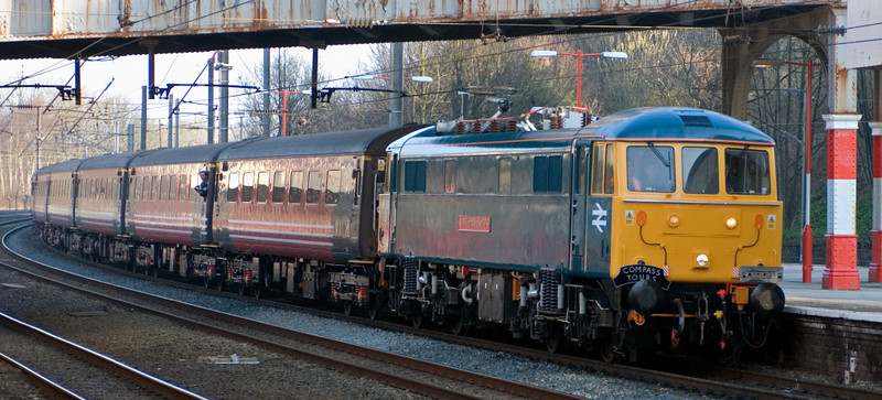 86101 Sir William A Stanier FRS, 1Z43, Lancaster,Sat  24 March 2007 - 0749 1.  86101 calls at Lancaster with Compass's Ynys Mon Tour from Carlisle to Holyhead.  This was 86101's railtour debut in preservation.  The train comprised 13 former Virgin Mk 2s, with 47815 on the rear.
