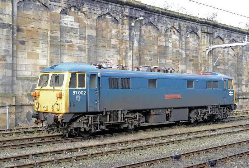 87002 Royal Sovereign, Carlisle, Thurs 11 April 2013 - 0915.  Probably my last ever photo of Britain's last operational 87.   It had spent the winter at Carlisle on Ice Maiden OHLE ice-breaking duties with 86101, and is seen awaiting haulage to Willesden by 47245.  It could not run under its own power because it has not been fitted with GSM-R cab radio, now mandatory south of Rugby.  It is expected that the AC Loco Group will sell 87002 for export to Bulgaria.  47245 had just taken 86101 from the station to the freight terminal at Brunthill for removal by road because of wheel flats.