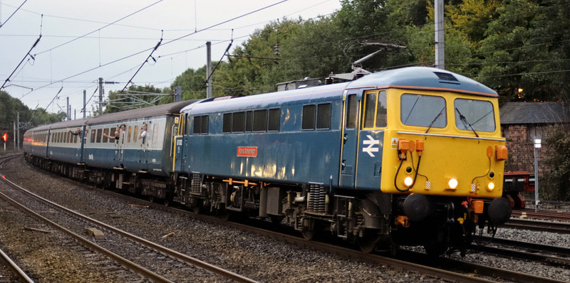 87002 Royal Sovereign, 1Z89, Lancaster, Fri 10 September 2010 - 1922.    Charging south with the return leg of Rail Blue Charters' Watford Junction - Edinburgh 'West Coast Premier'.  Its 13 coaches of mainly Cargo D stock comprised 9506, 6173, 6122, 10202, 3374, 3366, 11086, 11064, 11071, 80042, 11084, 11065 and 10588.