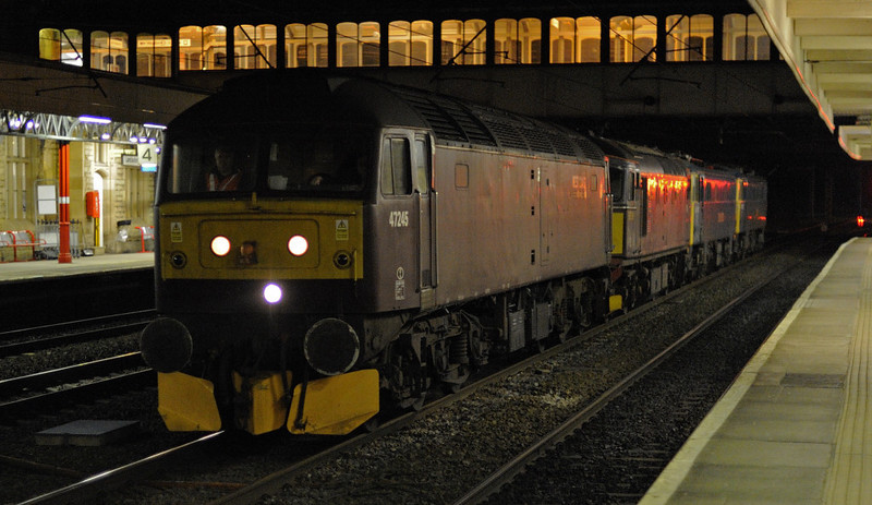 47245, 33029 Glen Loy, 86101 Sir William A Stanier FS & 87002 Royal Sovereign, 0Z87, Lancaster, Thurs 24 January 2013 - 2236 1.   Network Rail also hired the two electrics for Ice Maiden standby at Carlisle for winter 2012 - 2013.      WCRC's rarely seen Crompton had been stationed at Carlisle since the 17th for snowplough duties, and had taken them from Carlisle to Willesden for an exam very early on the 24th.  This extraordinary Willesden - Carlisle convoy had been joined by 47245 en route.