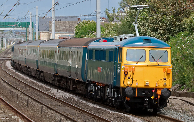 87002 Royal Sovereign, 1Z88, Hest Bank, Wed 16 July 2008 - 1420.   87002 is seen running over half an hour early on its return leg to Crewe.  At Carstairs it had run round its train, leaving 86101 on what became the rear.