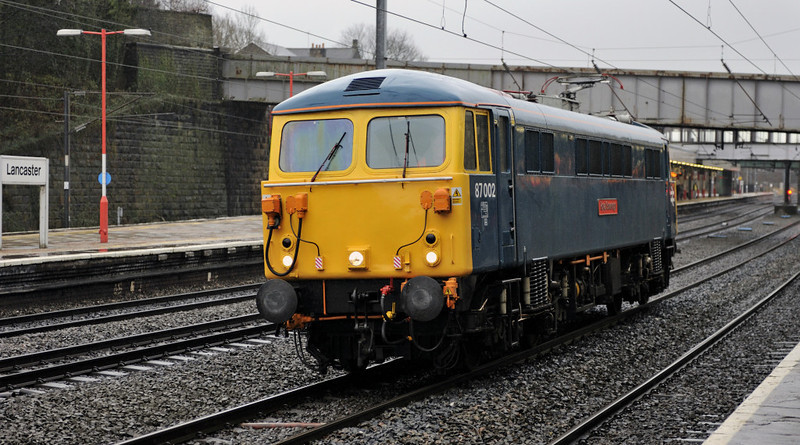 87002 Royal Sovereign, 0Z87, Lancaster, Fri 20 January 2012 - 1352.  The 87 heads from Willesden to Carlisle to replace 86101 and 86701 on 'Ice Maiden' catenary icebreaking standby duties.