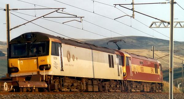 92031 The Institute of Logistics & Transport & 92004 Jane Austen, 4Z84, Greenholme, Fri 15 August 2003 - 1939.  EWS's 1502 Grangemouth - Daventry intermodal.  When class 92s run in pairs, the second loco is always dead.